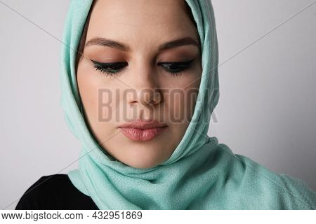 Close-up Of Arabian Young Woman Wearing Hijab, Isolated On White Wall.