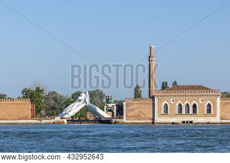 Venice, Italy - July 6, 2021: Lorenzo Quinn's Giant Stone Hands Represent Humanity's Universal Value
