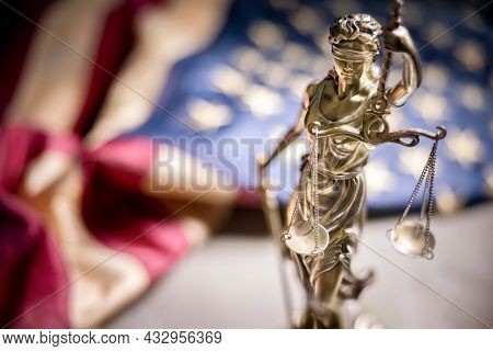 American legal system law concept statue of lady justice with scales of justice and american flag background