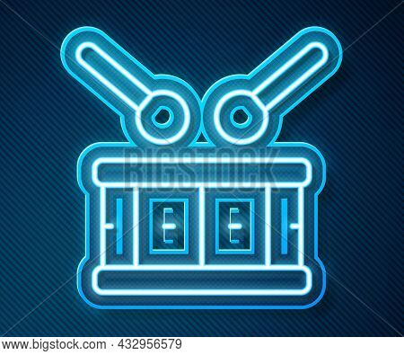 Glowing Neon Line Drum With Drum Sticks Icon Isolated On Blue Background. Music Sign. Musical Instru