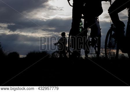 Silhouette Of A Cyclists In The Light Of The Setting Sun