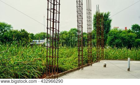 Rusty Reinforcement In Concrete And Industrial Reinforced Concrete Slabs Used In The Construction Of