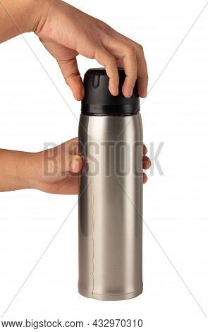 Hands Are Holding On The Lid Of The Water Bottle To Twist And Open The Silver Glossy Metal Vacuum Th
