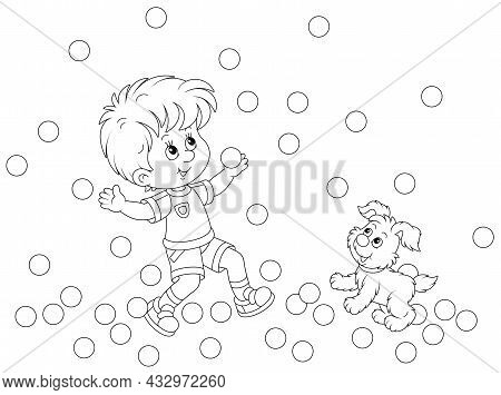 Happy Little Boy And His Cute Merry Pup Playing With Small Jumping Balls On A Playground, Black And