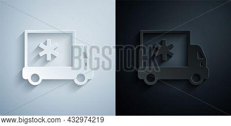 Paper Cut Ambulance And Emergency Car Icon Isolated On Grey And Black Background. Ambulance Vehicle