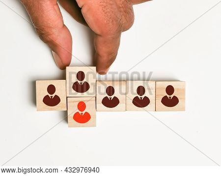 Employee Icons On Wooden Cubes With Single Red Color. Concept Of Staff Replacement.