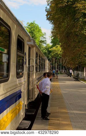 Kyiv, Ukraine-august 22, 2021:Сhildren In The Role Of Train Conductors, Waiting For Passengers Near