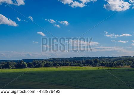 Picturesque Summer Landscape With White Fluffy Summer Clouds On Blue Marvelous Sky View Background.