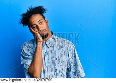 Young african american man with beard wearing casual clothes thinking looking tired and bored with depression problems with crossed arms.