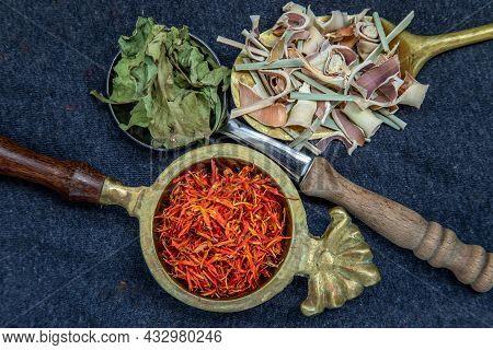 Wonderful Thai Herbal Tea With Dried Lemongrass Herb, Indian Marsh Fleabane And Safflower On Spoons.