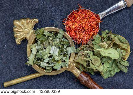 Wonderful Thai Herbal Tea With Dried Pandan Herb, Indian Marsh Fleabane And Safflower On Spoons. Sel