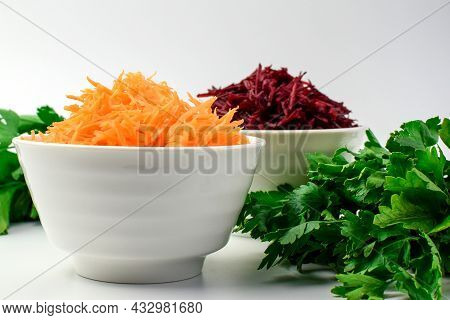 Grated Carrots And Grated Beets In A White Bowl, Fresh Herbs For Making Dinner. Set Of Vegetables An