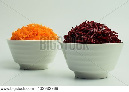 Grated Carrots And Grated Beets In A White Bowl. Set Of Vegetables For Cooking Lunch. Selective Focu