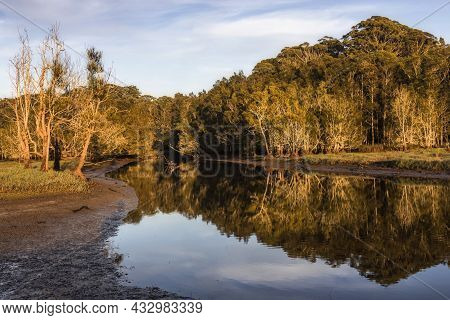 Reflections On The Water At Avoca Lagoon On Nsw Central Coast