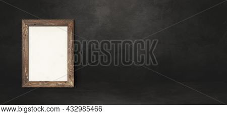 Wooden Picture Frame Leaning On A Black Wall. Presentation Mockup Template. Horizontal Banner