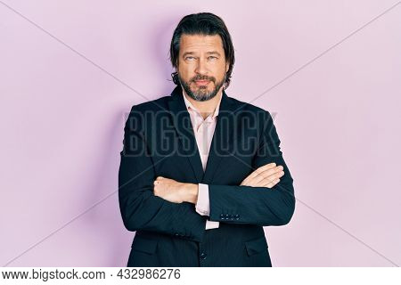 Middle age caucasian man wearing business clothes with arms crossed gesture relaxed with serious expression on face. simple and natural looking at the camera.