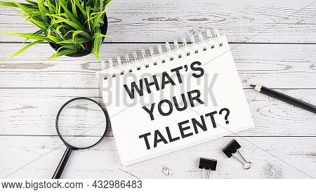 What's Your Talent Text Concept Write On Notebook With Office Tools On Wooden Background