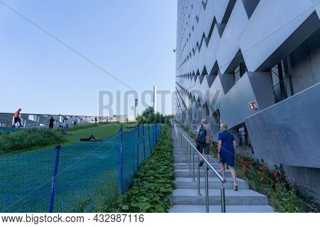 Copenhagen, Denmark - June 18, 2021: People Walking Up The Stairs Next To An Artificial Skiing Slope