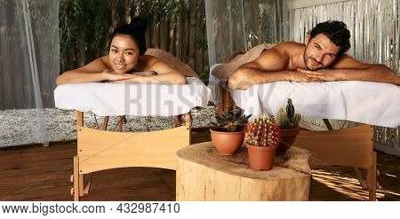 Happy Couple Lying On Massage Tables While Romantic Weekend At Spa Wellness Resort. Massage And Rest