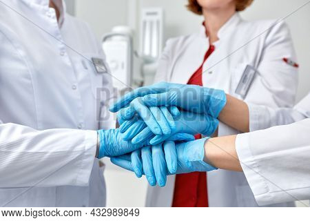 Hands In Blue Gloves Covid, Concept - Creative Team With Hands On Top Of Each Other. Diverse Team Pu