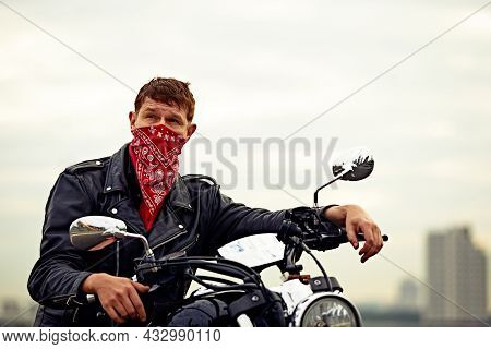 Young Man Riding Big Bike , Motorcycle On City Road Against Urban And Town Building Scene