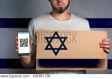 A Man With A Cardboard And A Phone In His Hand. The Flag Of Israel. Concept Of Freedoms And Human Ri