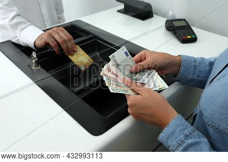 Woman Taking Money From Card In Bank, Closeup. Currency Exchange