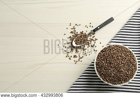 Ceramic Bowl With Chia Seeds On White Wooden Table, Flat Lay And Space For Text. Cooking Utensils