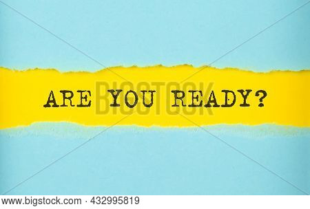 Are You Ready Text On Torn Paper , Yellow Background