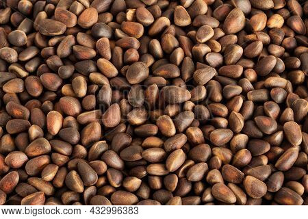 Pine Nuts Background. Gastronomic Background. Healthy Snacks. Inshell Pine Nuts