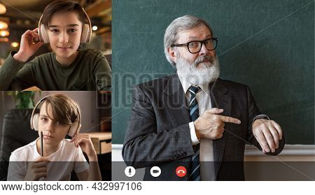 Two Boys, Students Studying By Group Video Conference With Each Other And Old Professor, Teacher. On