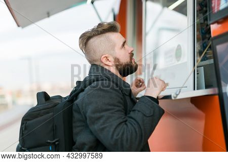 Portrait Of Man Choosing Fast Food In Food Truck In The Street. Meal, Food Industry And Streetfood C
