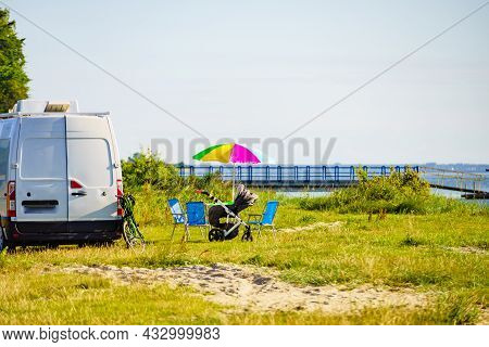 Colorful Umbrella And Chairs At Campervan On Beach. Picnic On Sea Shore. Caravan Family Vacation.