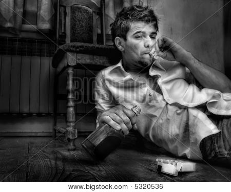 Young Man,drunkard Sitting In Old Room