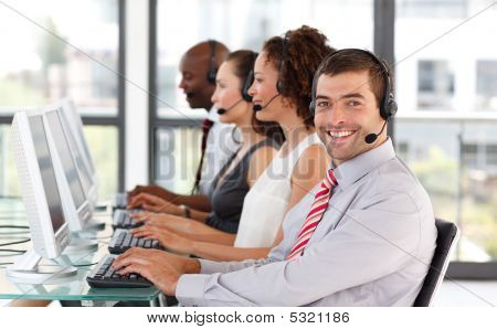 Smiling Businessman Working In A Call Center