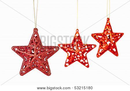 Christmas Decoration. Red Stars On White Background. Selective Focus