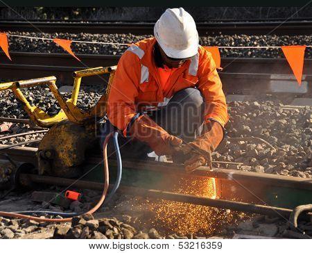 Rail Welder cutting rail with oxy torch