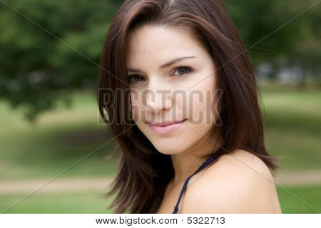 Fresh Faced Girl With Green Background