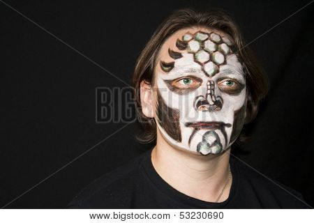 Make-up Of A Dragon On A Man's Face