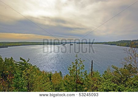 Clouds And Light Over A Wilderness Lake