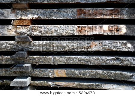 closeup photo of wheathered stacked wood boards poster