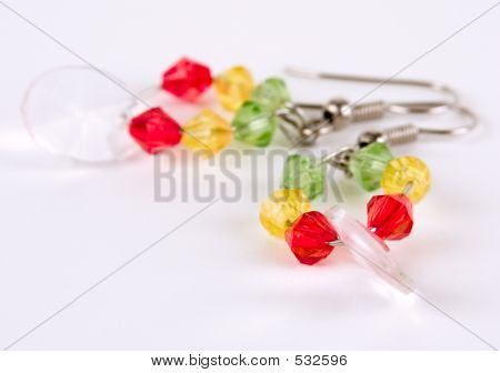 Colorful earring against white background poster