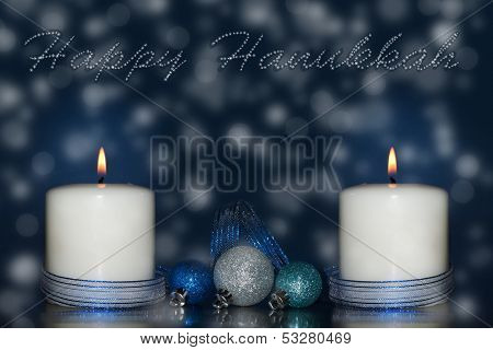 Two candles with blue ribbon and decorations with dreamy background and happy Hanukkah -text in stars