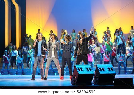 MOSCOW - JUN 23: Group Heroes with graduates on stage of State Kremlin Palace on Graduate of 2013 on June 23, 2013 in Moscow, Russia.