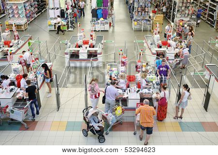 SAMARA, RUSSIA - JULY 7: Shoppers at the checkout lane Auchan hypermarket, July 7, Samara. In Russia there are more than a hundred stores Auchan