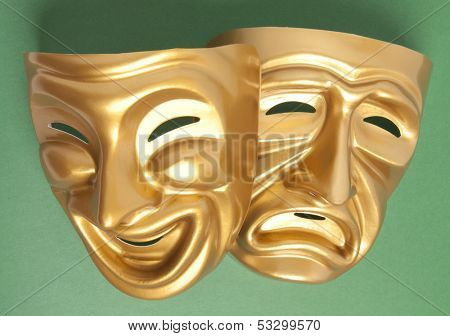 Comedy and Tragedy theatrical mask on a green background  poster