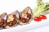 Delicious Oysters on a dish with lemon and vegetables poster