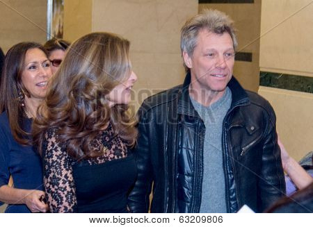 NEW YORK-MAR 13: Singer Jon Bon Jovi (R) and Maria Shriver attend the 'Paycheck To Paycheck: The Life And Times Of Katrina Gilbert' premiere at HBO Theater on March 13, 2014 in New York City.