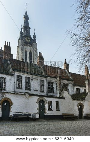 Kortrijk Beguinage And The Tower Of St. Martin's (maarten) Church.