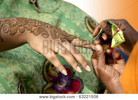 Applying henna- temporary tattooing